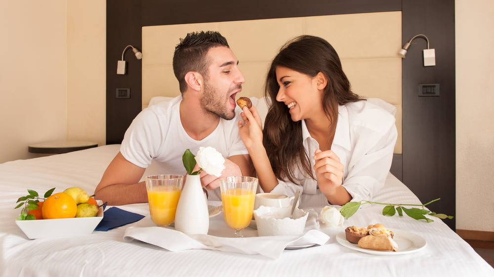 Eat Healthy On Vacation, couple on bed